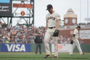 San Francisco Giants pitcher Sam Dyson (49) walks off the mound during a pitching change in the eighth inning as the New York Mets face the San Francisco Giants at AT&T Park in San Francisco, Calif., on Friday, June 24, 2017.