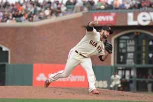 San Francisco Giants pitcher George Kontos (70) throws a pitch in the eighth inning as the New York Mets face the San Francisco Giants at AT&T Park in San Francisco, Calif., on Friday, June 24, 2017.