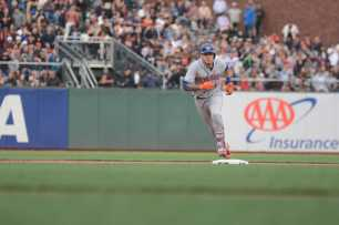 New York Mets third baseman Wilmer Flores (4) doubles to score a run in the eighth inning as the New York Mets face the San Francisco Giants at AT&T Park in San Francisco, Calif., on Friday, June 24, 2017.