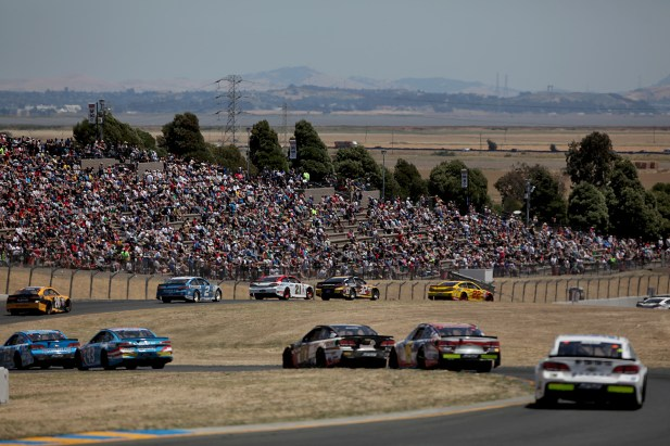 Fans watch as cars make one of the twelve turns at the Toyota/Save Mart 350 at Sonoma Raceway in Sonoma, Calif., on Sunday, June 24, 2017.