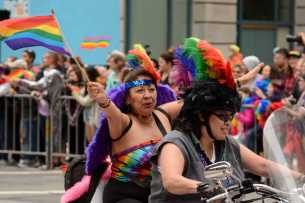 Women ride on a motorcycle at the Pride Celebration in San Francisco, Calif., on Sunday, June 25, 2017.