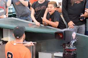 A young fan reacts after giving a fist bump to San Francisco Giants outfielder Hunter Pence (8) before the Miami Marlins face the San Francisco Giants at AT&T Park on Friday, July 7, 2017.