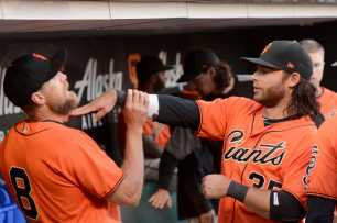 San Francisco Giants shortstop Brandon Crawford (35) and Giants outfielder Hunter Pence (8) play around before the Miami Marlins face the San Francisco Giants at AT&T Park on Friday, July 7, 2017.