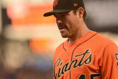 San Francisco Giants pitcher Matt Moore (45) walks off the mound during a pitching change in the fourth inning as the Miami Marlins face the San Francisco Giants at AT&T Park on Friday, July 7, 2017.