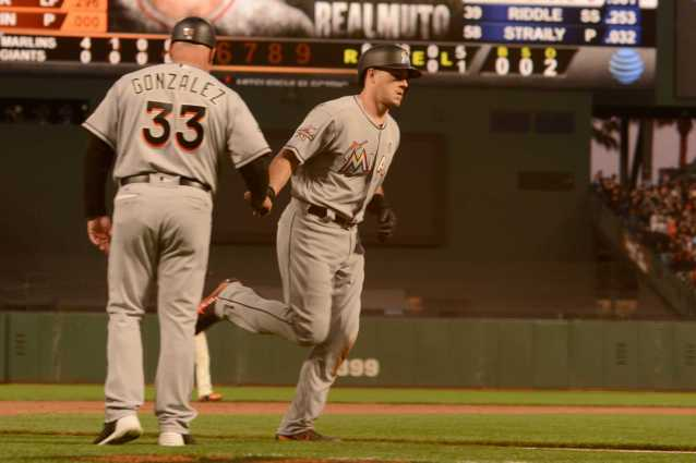 Miami Marlins catcher J.T. Realmuto (11) high-fives Marlins third base coach Fredi Gonzalez (33) after hitting a home run in the fifth inning as the Miami Marlins face the San Francisco Giants at AT&T Park on Friday, July 7, 2017.