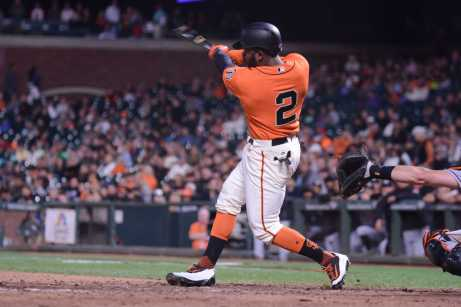 San Francisco Giants center fielder Denard Span (2) crushes a home run in the ninth inning as the Miami Marlins face the San Francisco Giants at AT&T Park on Friday, July 7, 2017.