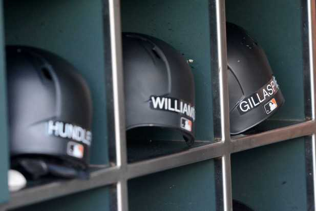Baseball helmets sit in individual cubbies in the Giants bullpen as the Miami Marlins face the San Francisco Giants at AT&T Park on Friday, July 8, 2017.