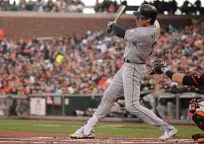 Miami Marlins center fielder Christian Yelich (21) hits a run-scoring double in the first inning as the Miami Marlins face the San Francisco Giants at AT&T Park on Friday, July 8, 2017.