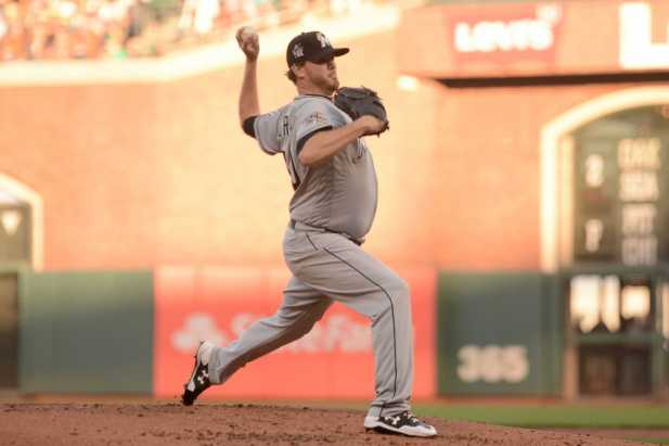 Miami Marlins pitcher Chris O'Grady (50) throws a pitch in the first inning in his MLB debut as the Miami Marlins face the San Francisco Giants at AT&T Park on Friday, July 8, 2017.