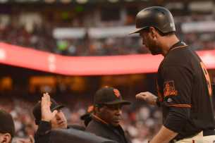 San Francisco Giants second baseman Brandon Belt (9) gives high-fives as he enters the Giants bullpen in the fourht inning as the Miami Marlins face the San Francisco Giants at AT&T Park on Friday, July 8, 2017.
