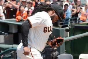 San Francisco Giants pitcher Johnny Cueto (47) runs out of the Giants dugout before the game as the Miami Marlins face the San Francisco Giants at AT&T Park on Friday, July 9, 2017.