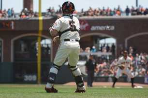 San Francisco Giants catcher Nick Hundley (5) throws to first base for the out in the first inning as the Miami Marlins face the San Francisco Giants at AT&T Park on Friday, July 9, 2017.