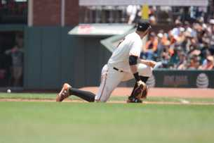 San Francisco Giants second baseman Brandon Belt (9) reacts after failing to field a ball in the third inning as the Miami Marlins face the San Francisco Giants at AT&T Park on Friday, July 9, 2017.