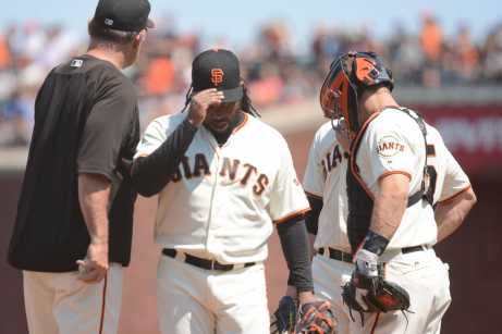 San Francisco Giants pitcher Johnny Cueto (47) removes his cap after Giants manager Bruce Bochy (15) takes the baseball from him during a pitching change in the seventh inning as the Miami Marlins face the San Francisco Giants at AT&T Park on Friday, July 9, 2017.