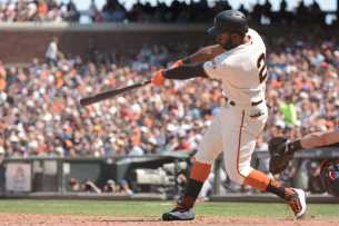 San Francisco Giants center fielder Denard Span (2) hits a run-scoring double in the seventh inning as the Miami Marlins face the San Francisco Giants at AT&T Park on Friday, July 9, 2017.