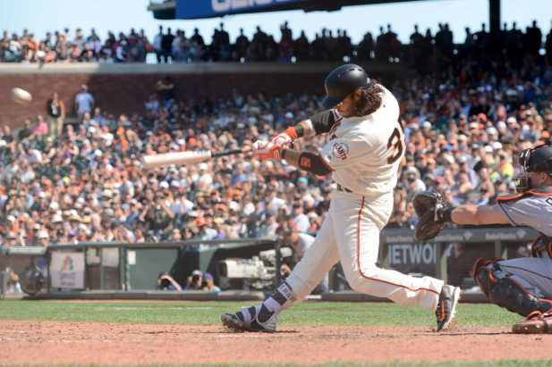 San Francisco Giants shortstop Brandon Crawford (35) hits a run-scoring single in the eighth inning as the Miami Marlins face the San Francisco Giants at AT&T Park on Friday, July 9, 2017.