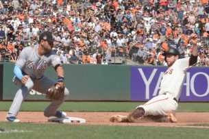 San Francisco Giants second baseman Brandon Belt (9) slides safely into third base in the eighth inning as the Miami Marlins face the San Francisco Giants at AT&T Park on Friday, July 9, 2017.