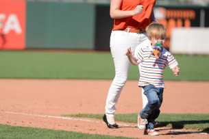 A young fan runs the bases after the Miami Marlins beat the San Francisco Giants at AT&T Park on Friday, July 9, 2017.