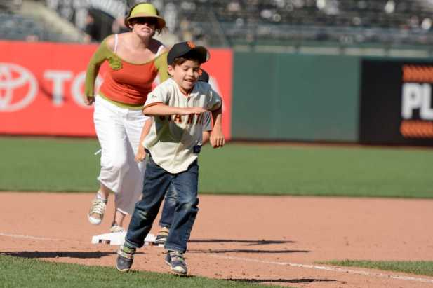 Young fans run the bases after the Miami Marlins beat the San Francisco Giants at AT&T Park on Friday, July 9, 2017.