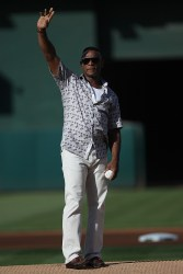 "Former Oakland Athletics great Rickey Henderson throws out the ceremonial first pitch on Rickey Henderson Home ""Oakland"" Jersey day as the Cleveland Indians face the Oakland Athletics at Oakland Coliseum in Oakland, Calif., on Saturday, July 15, 2017."