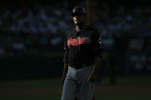 Cleveland Indians first base coach Sandy Alomar Jr. (15) walks back into the dugout after the third inning as the Cleveland Indians face the Oakland Athletics at Oakland Coliseum in Oakland, Calif., on Saturday, July 15, 2017.