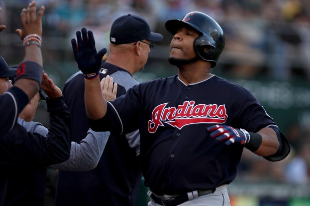 Cleveland Indians designated hitter Edwin Encarnacion (10) is congratulated after hitting a two-run home run in the fourth inning as the Cleveland Indians face the Oakland Athletics at Oakland Coliseum in Oakland, Calif., on Saturday, July 15, 2017.