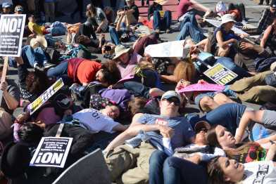 """Protesters hold a """"die-in"""" at an anti-Trump protest in San Francisco, Calif., on Saturday, July 15, 2017."""