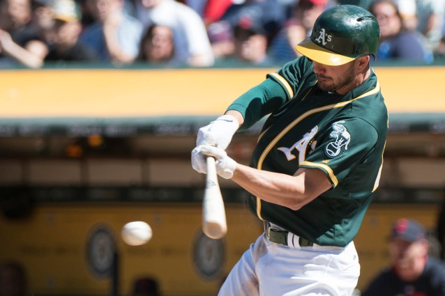 Oakland Athletics right fielder Matt Joyce (23) hits a two-run single in the eighth inning against the Cleveland Indians at the Oakland Coliseum in Oakland, Calif., on July 16, 2017.