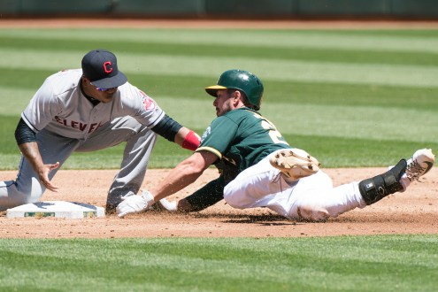 Cleveland Indians second baseman Jose Ramiez (11) tags Oakland Athletics right fielder Matt Joyce (23) out as second as Joyce tried to stretch out a single into a double in the second inning of the game at the Oakland Coliseum in Oakland, Calif., on July 16, 2017.