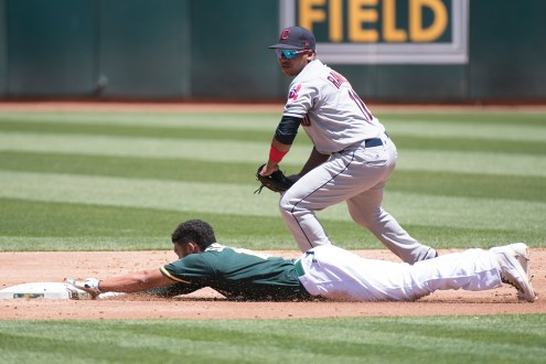 Oakland Athletics shortstop Marcus Semien (10) slides safely into second on a double in the second inning of the game against the Cleveland Indians at the Oakland Coliseum in Oakland, Calif., on July 16, 2017.