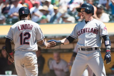 Cleveland Indians shortstop Francisco Lindor (12) and right fielder Brandon Guyer (6) celebrate after scoring in the fourth inning of the game against the Oakland Athletics at the Oakland Coliseum in Oakland, Calif., on July 16, 2017.