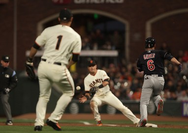 Cleveland Indians right fielder Brandon Guyer (6) beats out an infield hit as San Francisco Giants infielder Jae-Gyun Hwang (1) commits a throwing error that plated a run in the sixth inning as the Cleveland Indians face the San Francisco Giants at AT&T Park in San Francisco, Calif., on Monday, July 17, 2017.