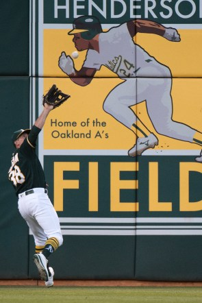 Oakland Athletics center fielder Jaycob Brugman (38) catches a fly ball in the fourth inning of the game against the Tampa Bay Rays at the Oakland Coliseum in Oakland, Calif., on July 17, 2017.