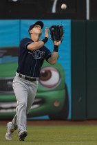 Tampa Bay Rays left fielder Corey Dickerson (10) catches a fly ball in the fourth inning of the game against the Oakland Athletics at the Oakland Coliseum in Oakland, Calif., on July 17, 2017.