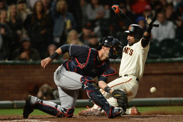 San Francisco Giants third baseman Eduardo Nunez (10) scores in front of Cleveland Indians catcher Yan Gomez (7) in the sixth inning as the Cleveland Indians face the San Francisco Giants at AT&T Park in San Francisco, Calif., on Tuesday, July 18, 2017.