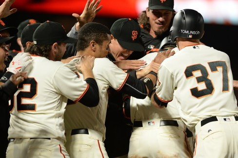 Players congratulate San Francisco Giants third baseman Eduardo Nunez (10) after a walk off hit in the tenth inning as the Cleveland Indians fall to the San Francisco Giants 2-1 at AT&T Park in San Francisco, Calif., on Tuesday, July 18, 2017.