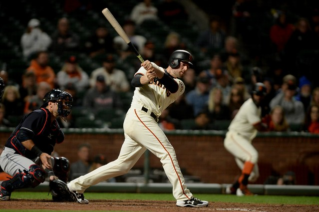 San Francisco Giants infielder Conor Gillaspie (21) eyes a double in the tenth inning as the Cleveland Indians face the San Francisco Giants at AT&T Park in San Francisco, Calif., on Tuesday, July 18, 2017.