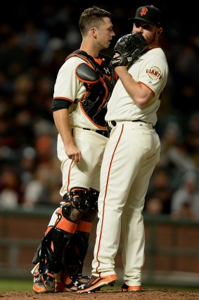 San Francisco Giants relied pitcher Sam Dyson (49) and catcher Buster Posey (28) chat in the ninth inning as the Cleveland Indians face the San Francisco Giants at AT&T Park in San Francisco, Calif., on Tuesday, July 18, 2017.