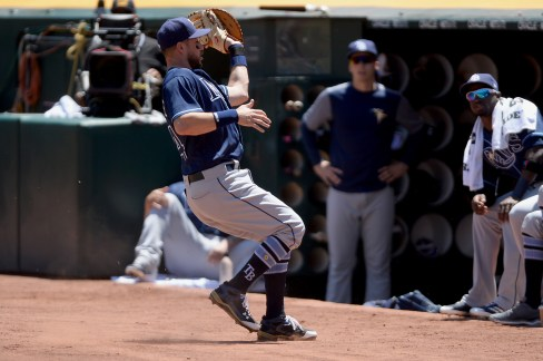 Tampa Bay Rays first baseman Trevor Plouffe (14) catches a foul ball in the first inning as the Tampa Bay Rays face the Oakland Athletics at Oakland Coliseum in Oakland, Calif., on Wednesday, July 19, 2017.