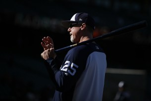 San Diego Padres bench coach Mark McGwire (25) stands on the field during batting practice before the San Diego Padres face the San Francisco Giants at AT&T Park in San Francisco, Calif., on Thursday, July 20, 2017.