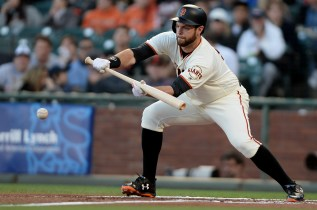 San Francisco Giants first baseman Brandon Belt (9) grounds out in a bunt attempt in the first inning as the San Diego Padres face the San Francisco Giants at AT&T Park in San Francisco, Calif., on Thursday, July 20, 2017.