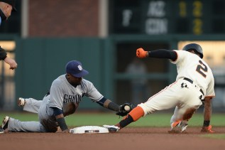 San Francisco Giants center fielder Denard Span (2) doubles in the fourth inning as San Diego Padres second baseman Jose Pirela (2) applies the late tag as the San Diego Padres face the San Francisco Giants at AT&T Park in San Francisco, Calif., on Thursday, July 20, 2017.