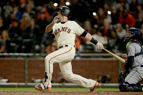 San Francisco Giants catcher Buster Posey (28) flies out with the bases loaded in the eighth inning as the San Diego Padres face the San Francisco Giants at AT&T Park in San Francisco, Calif., on Thursday, July 20, 2017.