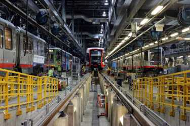 A new Muni train sits inside the Muni Metro East Rail Facility in San Francisco, Calif., on Friday, July 21, 2017. The train will replace its 151-train fleet and add an additional 64 by August 20, 2017.