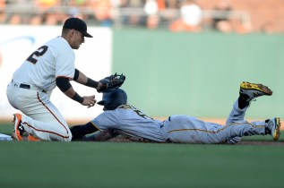Pittsburgh Pirates left fielder Starling Marte (6) steals second base underneath the tag of San Francisco Giants second baseman Joe Panik (12) in the first inning as the Pittsburgh Pirates face the San Francisco Giants at AT&T Park in San Francisco, Calif., on Monday, July 24, 2017.