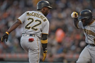 Pittsburgh Pirates center fielder Andrew McCutchen (22) celebrates with second baseman Josh Harrison (5) after s a 3-run home run in the second inning as the Pittsburgh Pirates face the San Francisco Giants at AT&T Park in San Francisco, Calif., on Monday, July 24, 2017.