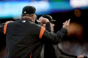 San Francisco Giants manager Bruce Bochy (15) is ejected in the second inning by home plate umpire Chris Conroy (98) as the Pittsburgh Pirates face the San Francisco Giants at AT&T Park in San Francisco, Calif., on Monday, July 24, 2017.