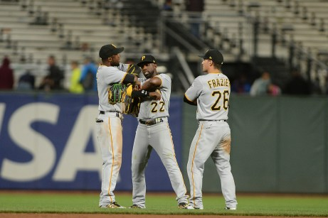 Pittsburgh Pirates left fielder Starling Marte (6), center fielder Andrew McCutchen (22) and right fielder Adam Frazier (26) celebrate a 10-3 victory over the San Francisco Giants at AT&T Park in San Francisco, Calif., on Monday, July 24, 2017.