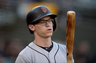 San Francisco Giants second baseman Kelby Tomlinson (37) waits on deck in the first inning as the San Francisco Giants face the Oakland Athletics at Oakland Coliseum in Oakland, Calif., on Tuesday, August 1, 2017.