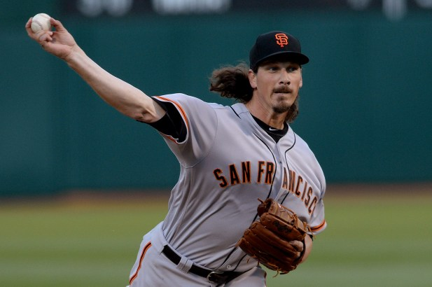 San Francisco Giants pitcher Jeff Samardzija (29) throws a pitch in the first inning as the San Francisco Giants face the Oakland Athletics at Oakland Coliseum in Oakland, Calif., on Tuesday, August 1, 2017.